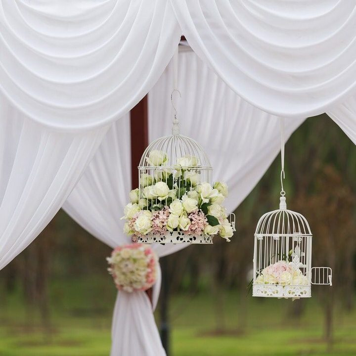 White draping and birdcage