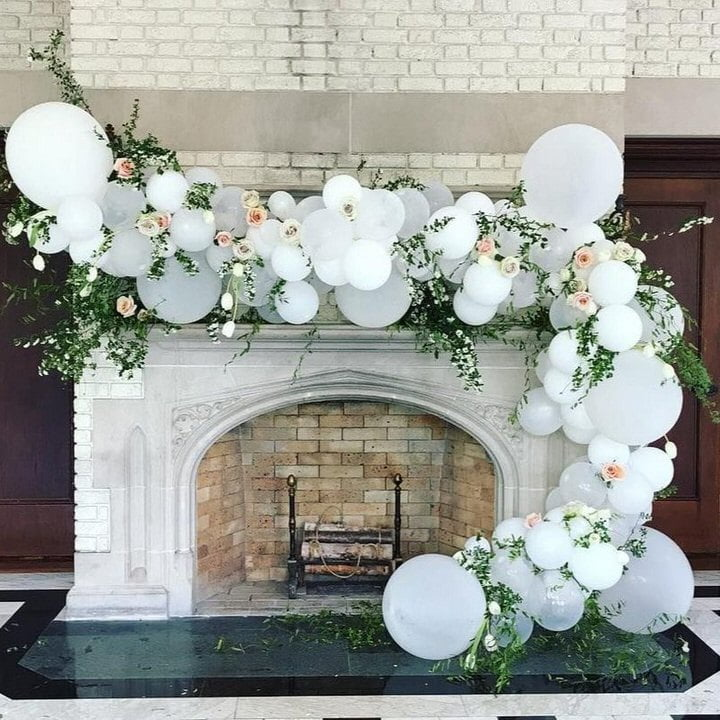 white balloons on fireplace