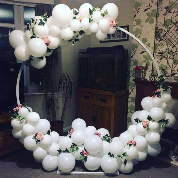 white balloons on arch