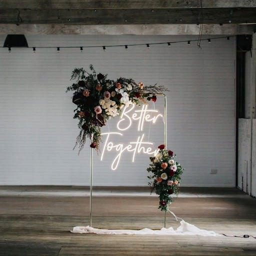 Better Together Neon Sign and flowers on copper frame