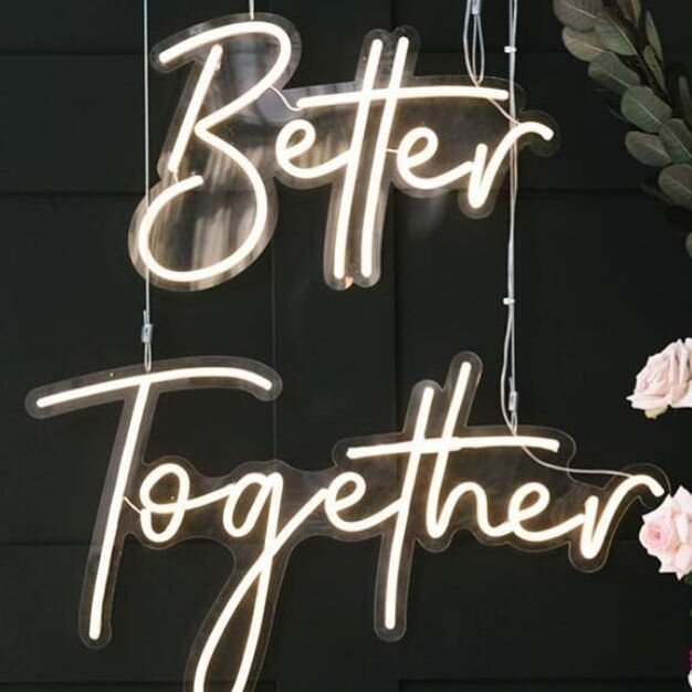 Better Together Neon Sign on dark background