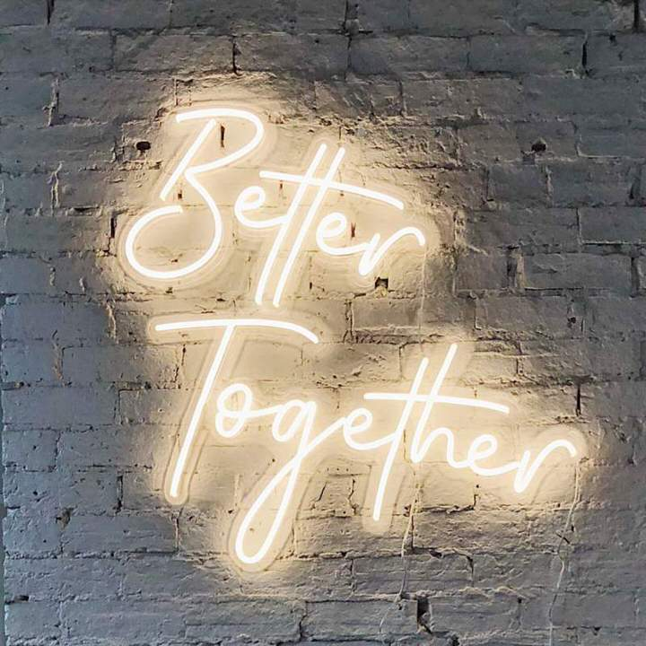 Better Together Neon Sign on white brick wall