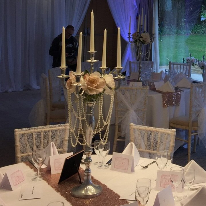 Candelabra draped with pearls