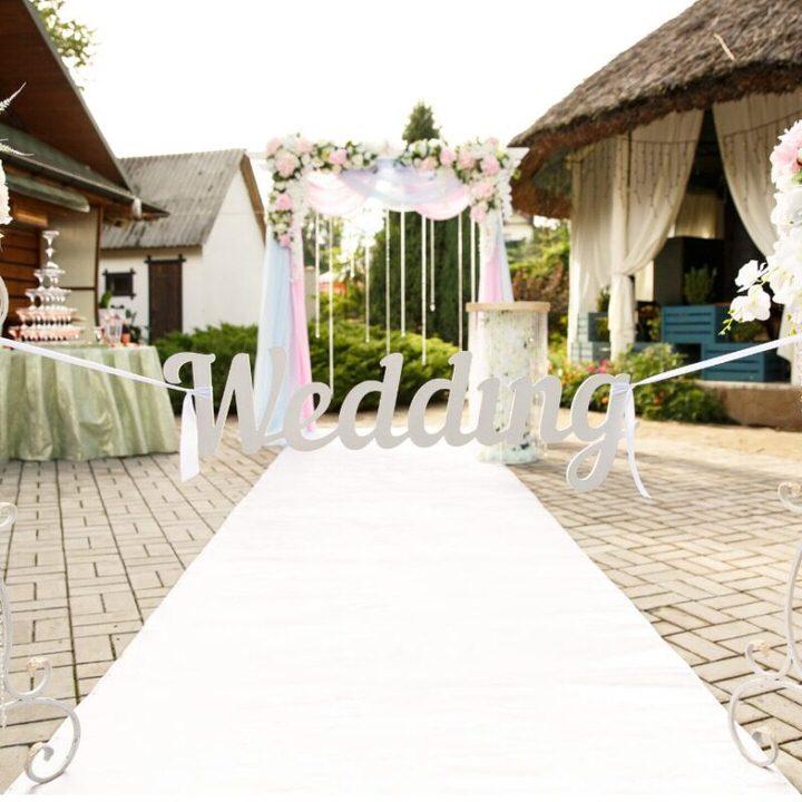 White carpet runner with wedding sign
