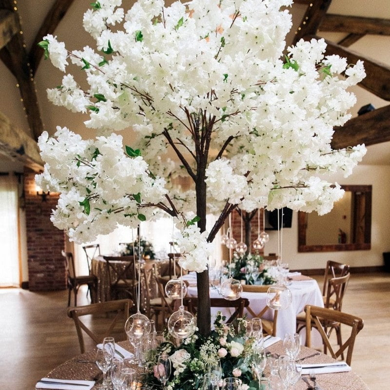 White cherry blossom tree with hanging teatlight globes