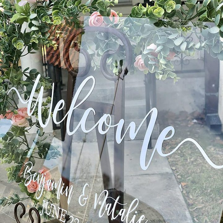 Clear Acrylic Welcome Sign Benjamin and Natalie on easel