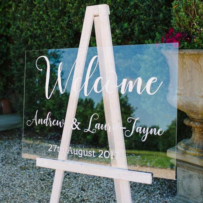 Clear Acrylic Welcome Sign Andrew and Lauar Jayne on pine easel