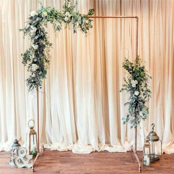 Copper Frame Backdrop with flowers and lanterns