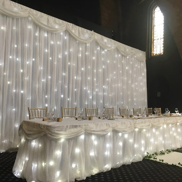 Fairy Light Backdrop with table and chairs