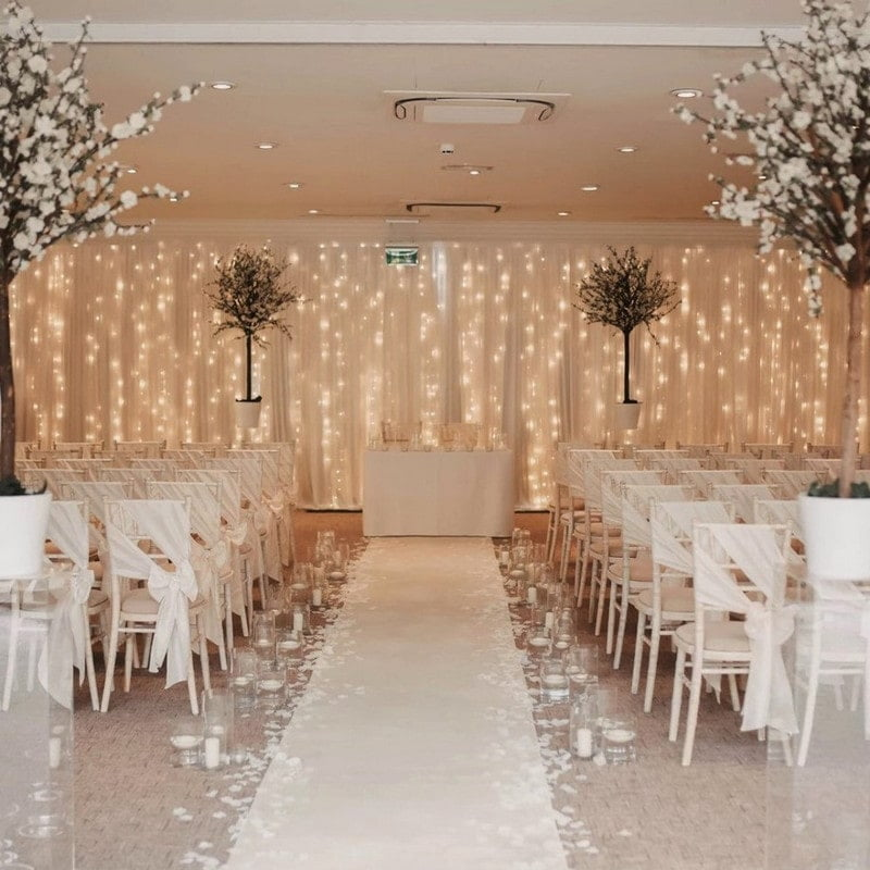 room with fairly light backdrop and white chairs