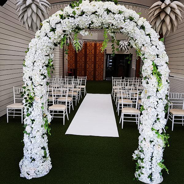 White Flower Arch & white carpet