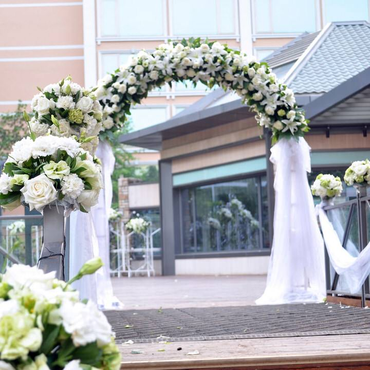 Flower Arch with white flowers and tuille oustside