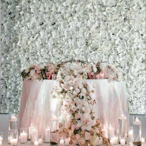 White Flower Wall with pink table & candles on floor