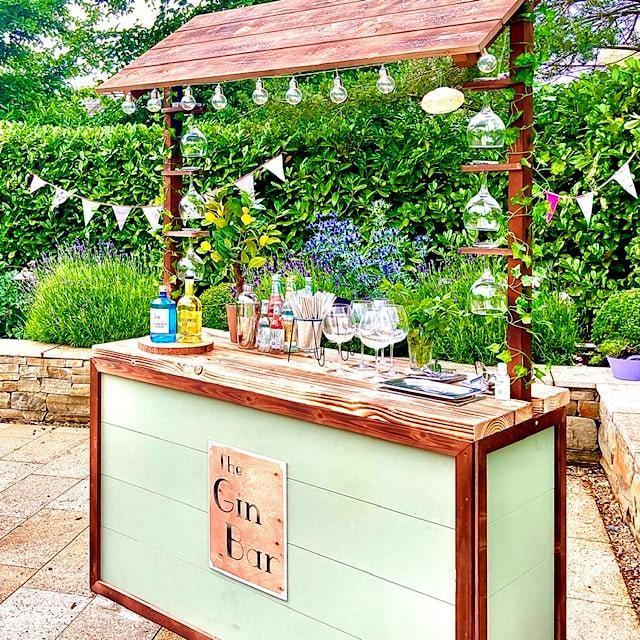 Wooden & turquoise Gin Bar in garden