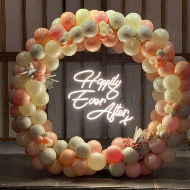 Happily Ever After sign on cream, peach & grey balloon hoop