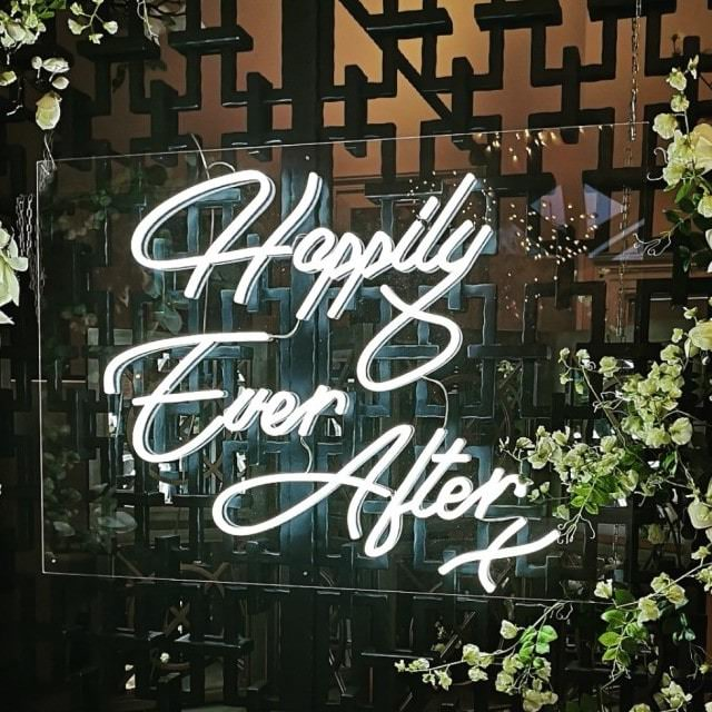 Happily Ever After sign on metal fence