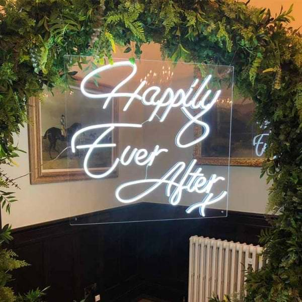 Happily Ever After sign on green moongate arch