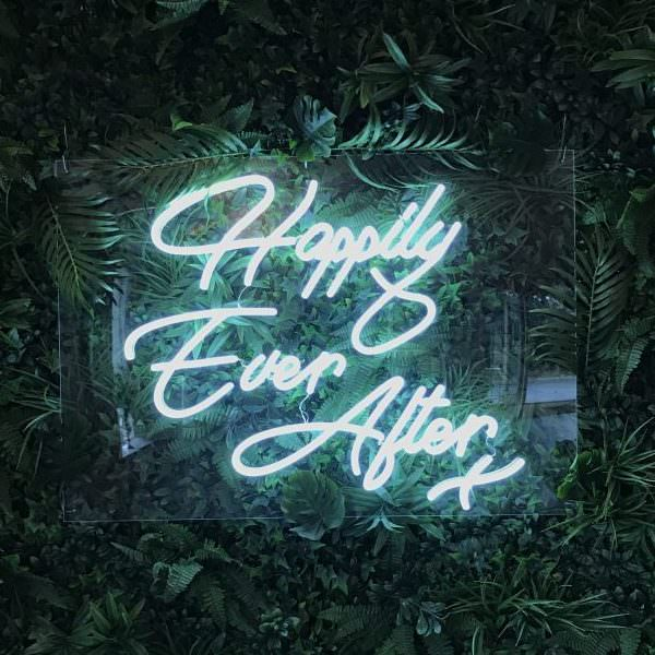 Happily Ever After sign on green leaves