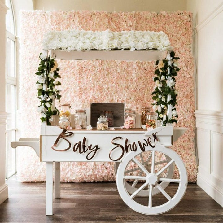 White Candy Cart with Baby shower sign & peach flower wall