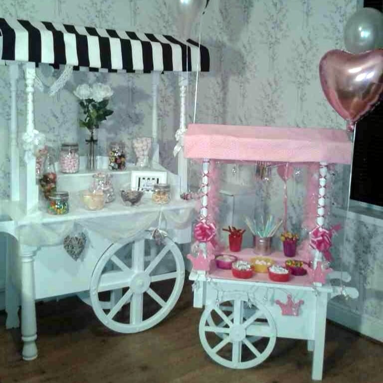 pink & white Mini Candy Cart beside large black & white Candy Cart