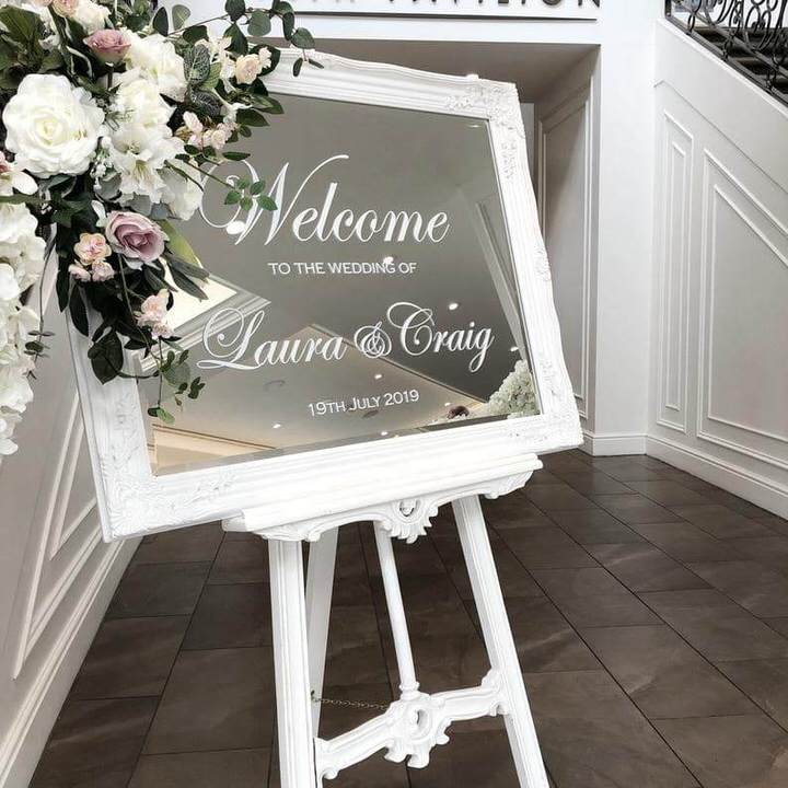 White frame Mirror Welcome Sign on white easel