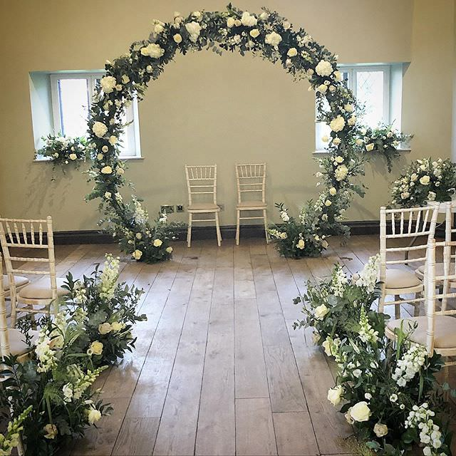 Green & cream Moon Gate Arch in room with chairs