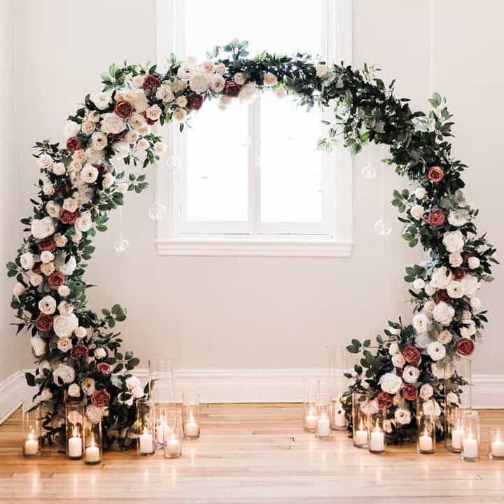 Green,white,red Moon Gate Arch with candles