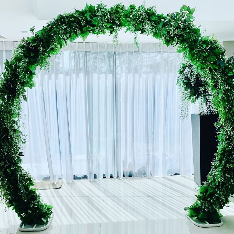 Green Moon Gate Arch in room with white curtains