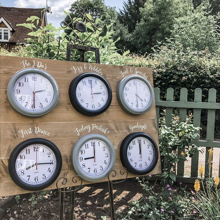 Wooden Order of The Day Sign with silver & black clocks
