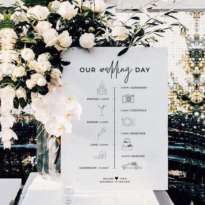 White Our Wedding Day Order of The Day Sign with white flowers