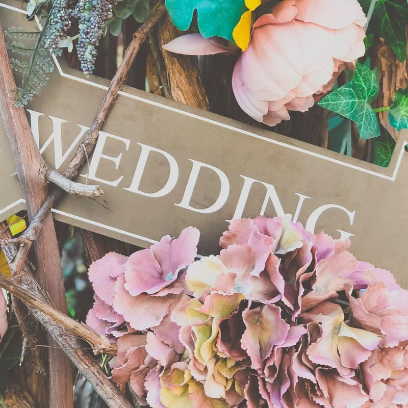 wooden wedding arrow sign with pink flowers