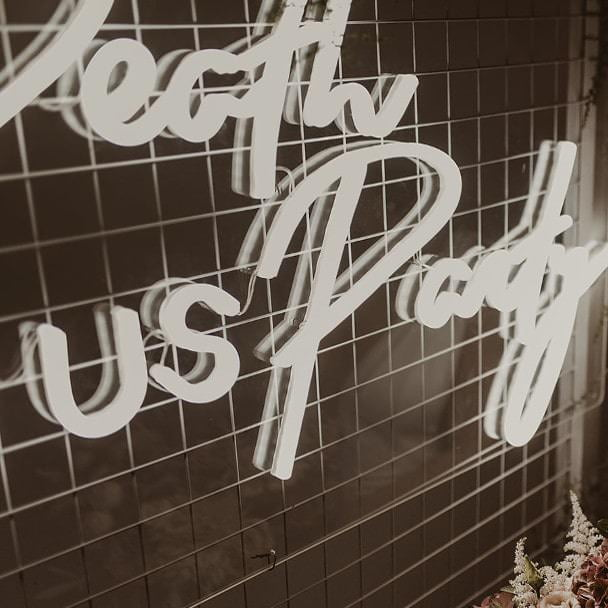 Til Death Do Us Party sign on metal mesh frame