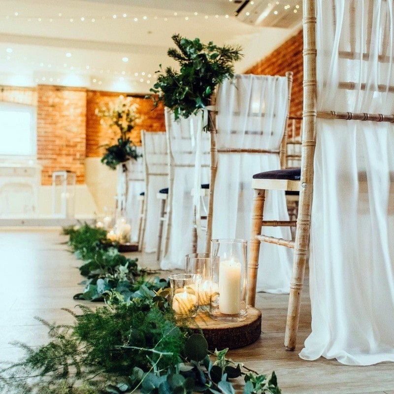 wedding chairs with white draping