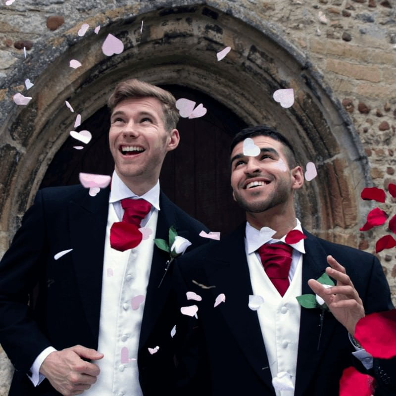 wedding couple outside church with confetti