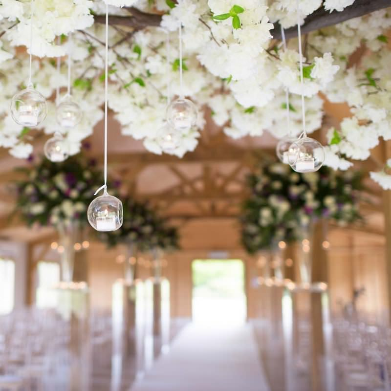 white flower branch with hanging tealight globes