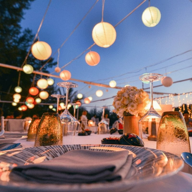 lanterns over set table