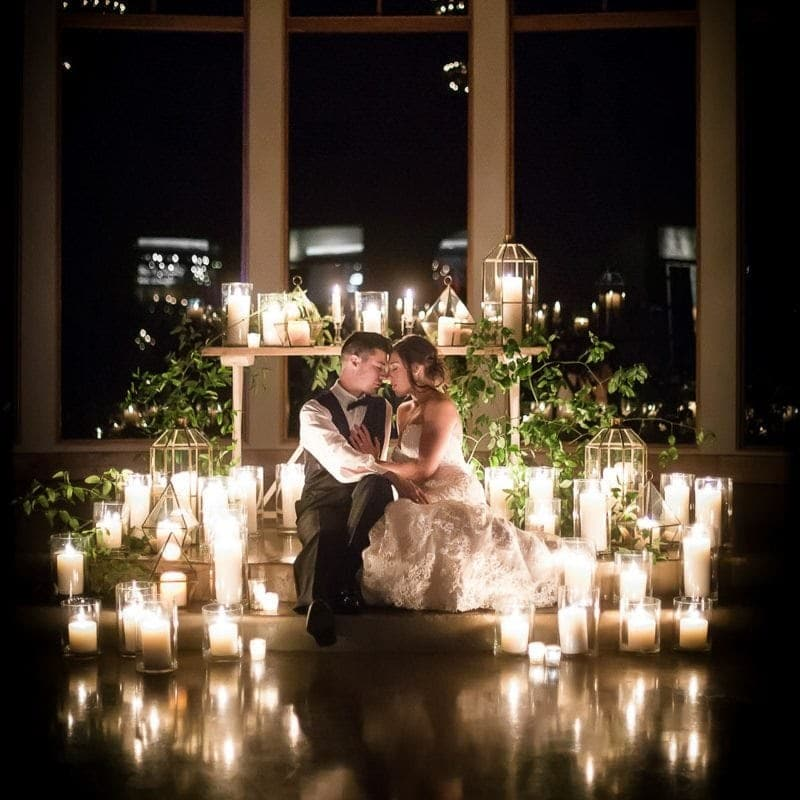 bride and groom in front of candles