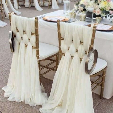 2 chairs decorated with white material