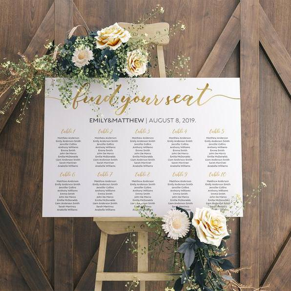 White Find your seat table plan Emily & Matthew on wooden easel