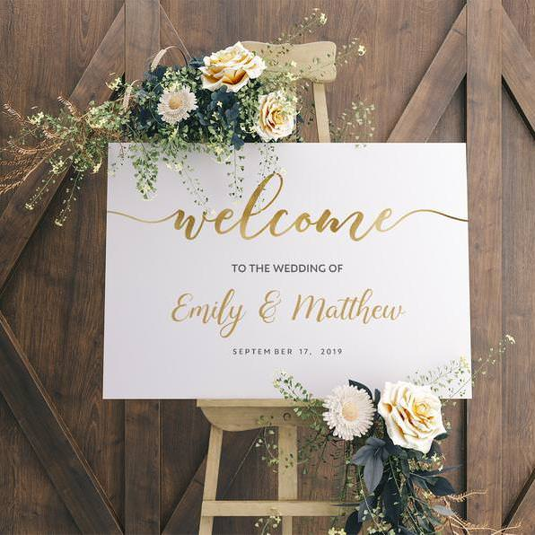 White Welcome Sign Emily & Matthew on wooden easel