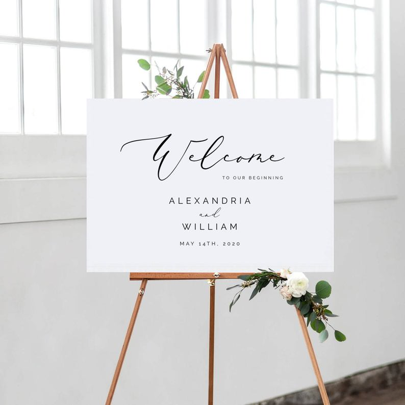 White Welcome Sign Alexandria & William on wooden easel