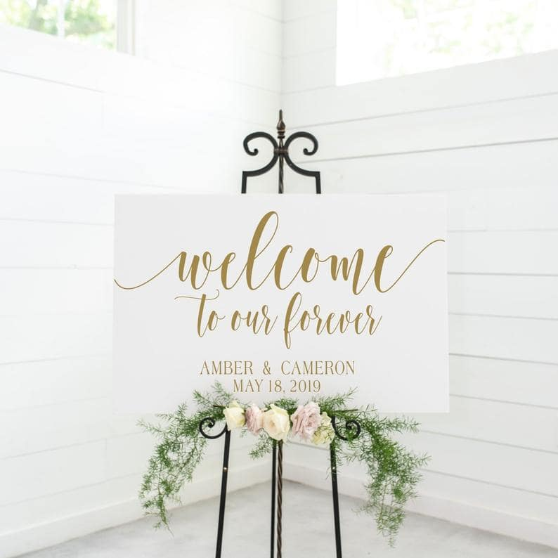 White Welcome Sign Amber & Cameron on black easel