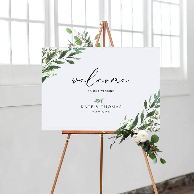 White Welcome Sign Kate & Thomas on wooden easel