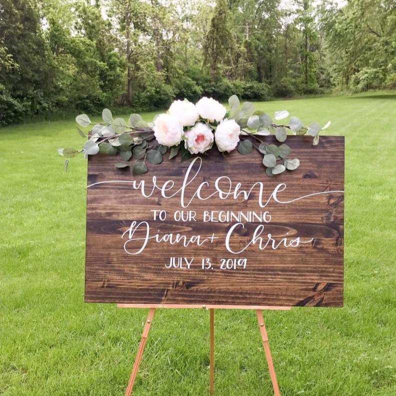 Wooden Welcome ro our beginning sign Diana & Chris on wooden easel