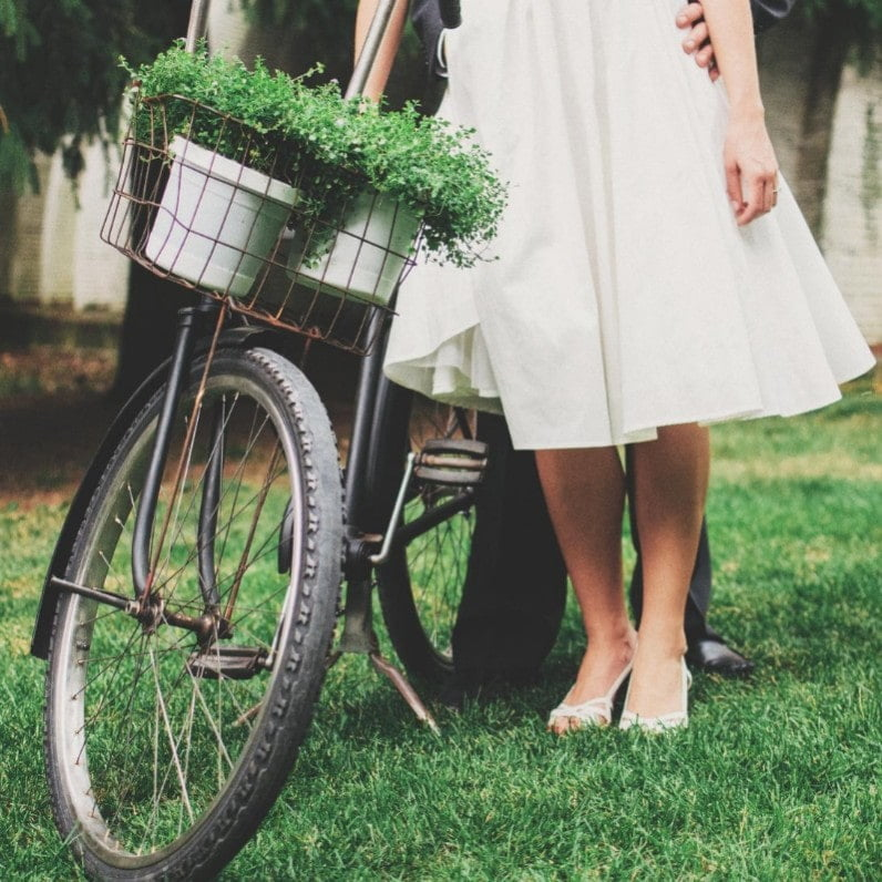 bride in front of bicycle