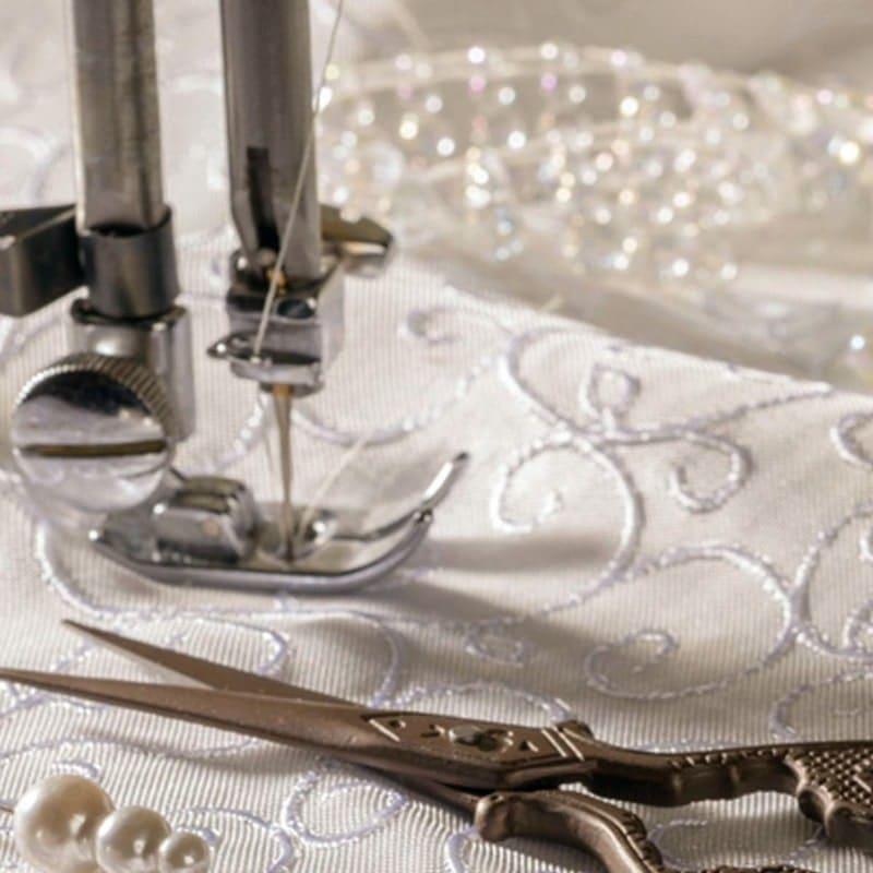 wedding dress being stitched